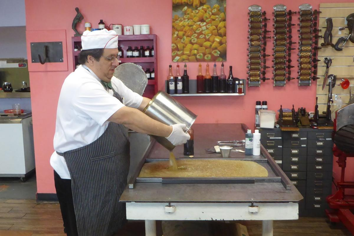 1.  Greg begins making his hard   image candy by pouring a 300-degree sugar mixture onto the cooling   table..JPG