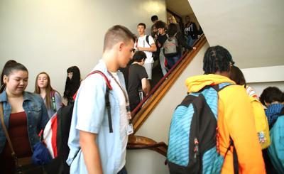 Truancy, student moves challenge District 118