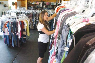 ecf0282145e8 Foster s Closet owner Sherry Jones sorts through clothing at her new shop  for foster children.