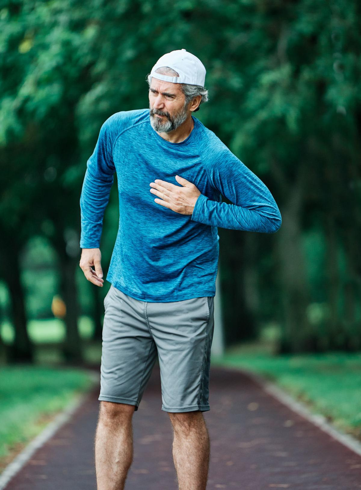 senior man running exercising sport fitness chest pain heart attack