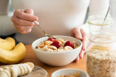 Woman eating oatmeal porridge