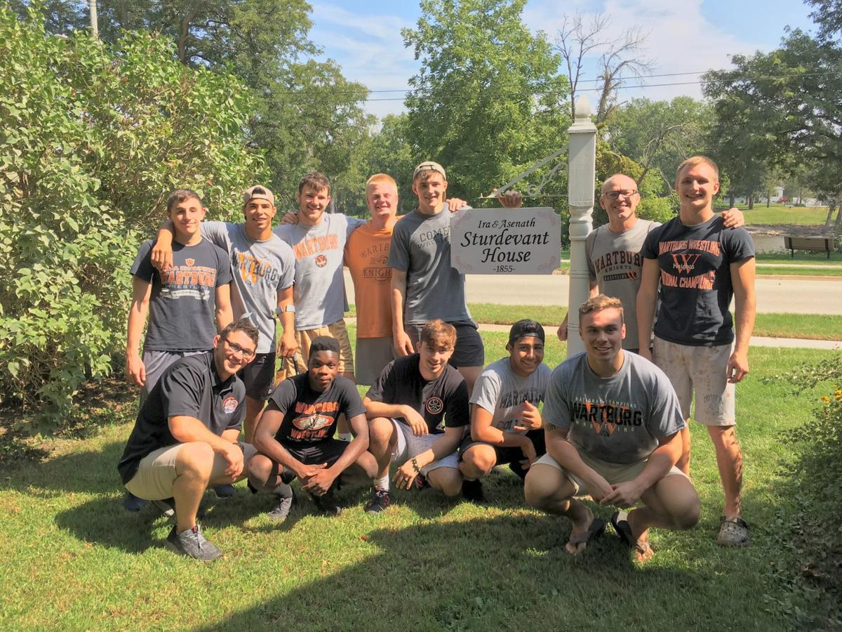 Wartburg wrestling helps restore yard outside historic house
