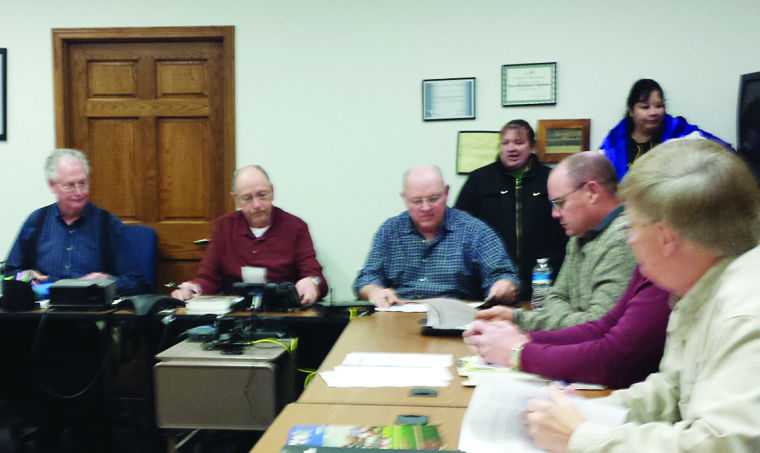 Butch Rorabaugh, left, EBTC General Manager and members of the Board take notes during David McElroy's presentation at their Jan. 9 meeting.