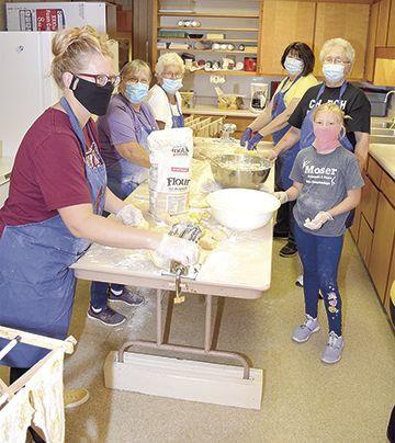 Volunteers make noodles in Brandon
