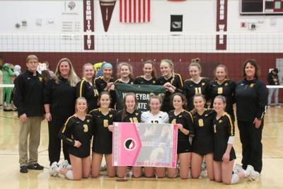 Janesville poses with banner