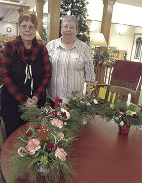 Garden club members with living centerpieces