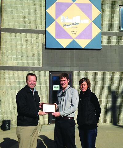 Left to right Tom Westhoff, Senior Energy Services Representative, Ryan Nielsen, Wapsie Valley Creamery, and Melissa Hearn, Community Relations and Marketing Director.