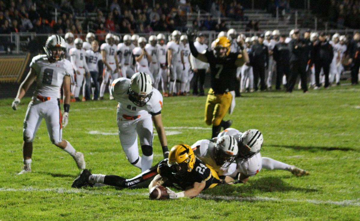 Cael White stretches for a touchdown