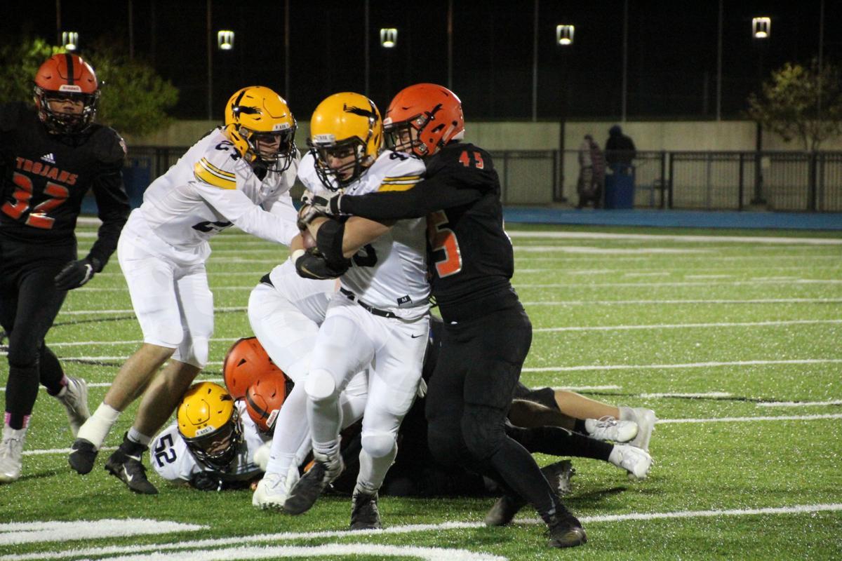 Hagarty carries Trojan tackler
