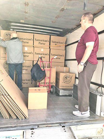 Volunteers load trucks