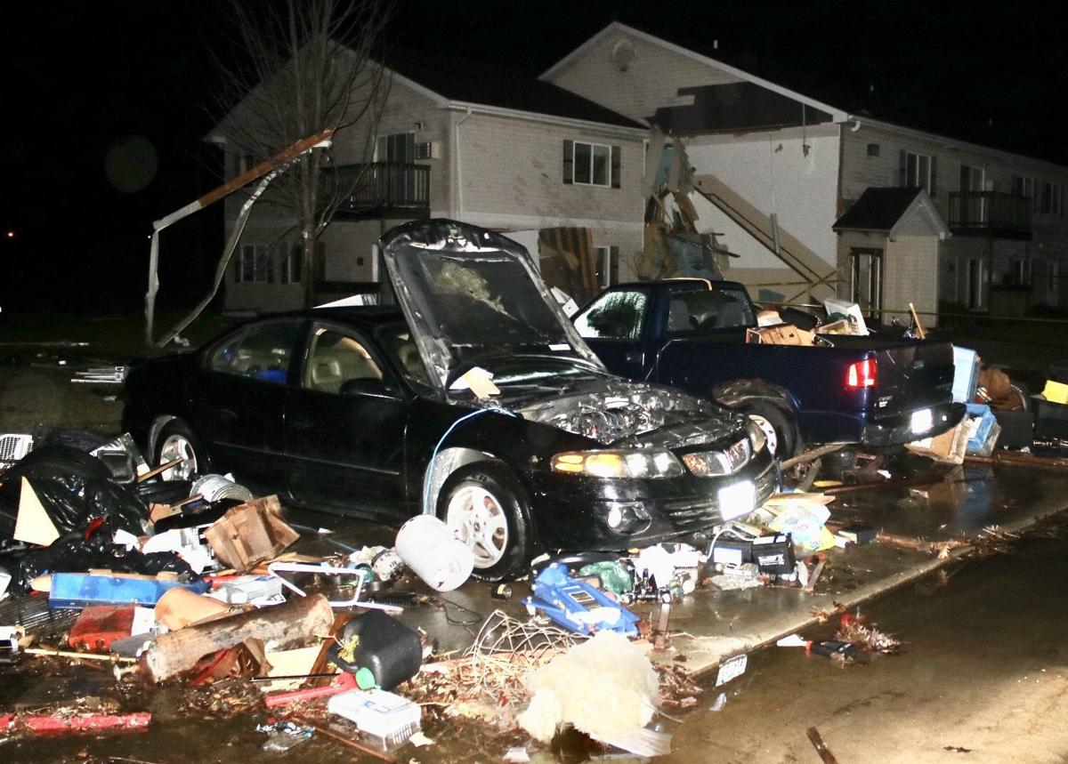 Wind damage, cars at The Meadows apartment homes