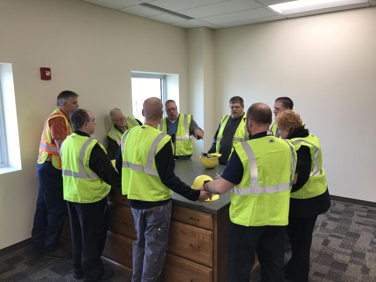 Workers bless the new East Penn building
