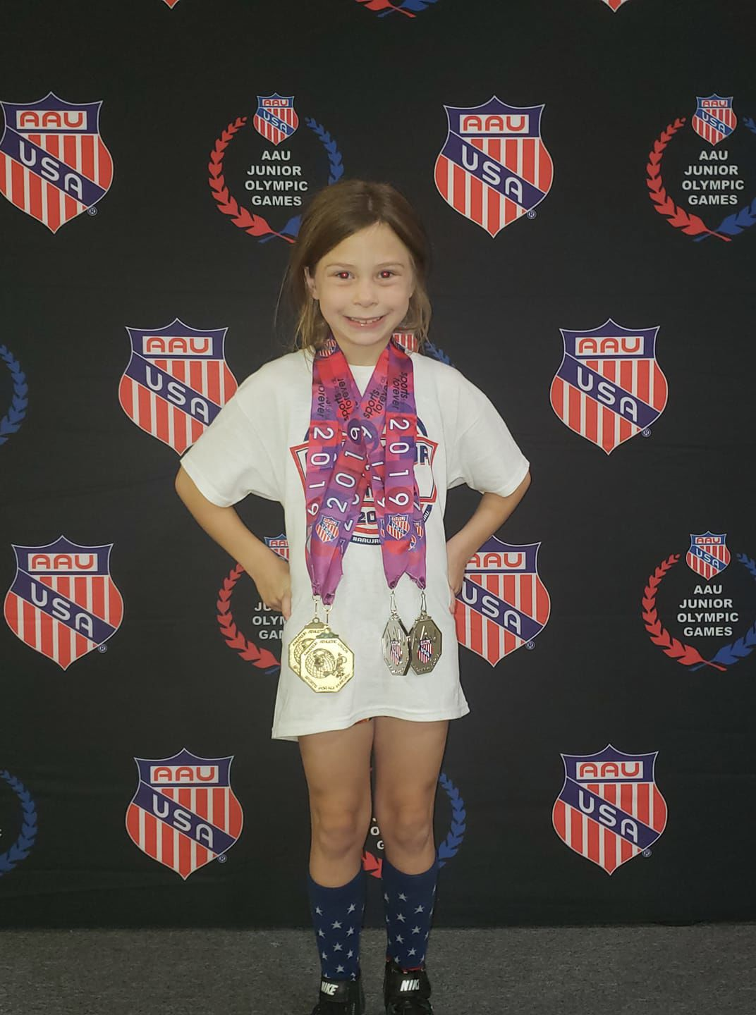 Abbie Peterson with medals