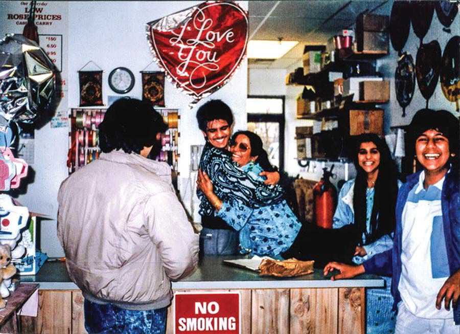 A happy occasion in the East Haven flower shop in the late '80s. Tariq is hugging his mother, Salma. In the photo is also his sister and brother.jpg