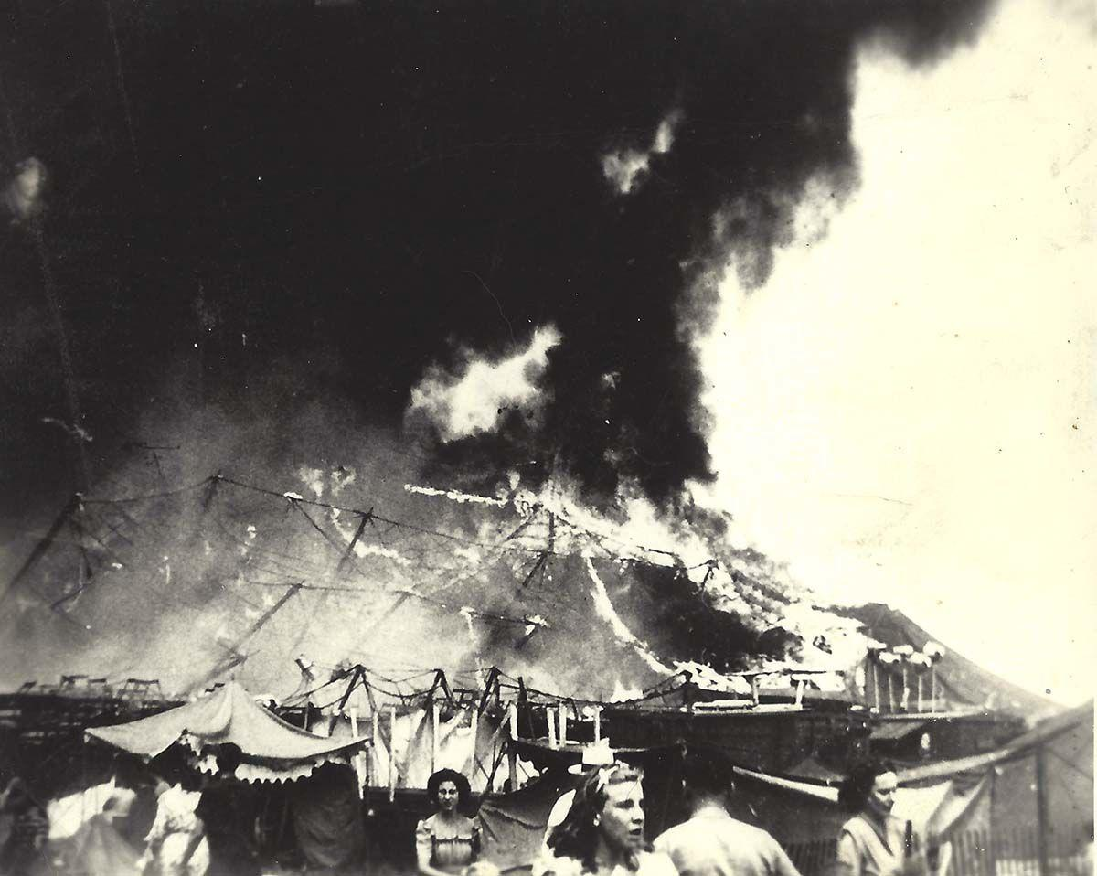014: Photo by (probably) Spencer Torell, from author's collection. Big Top fully engulfed in flames as women flee.
