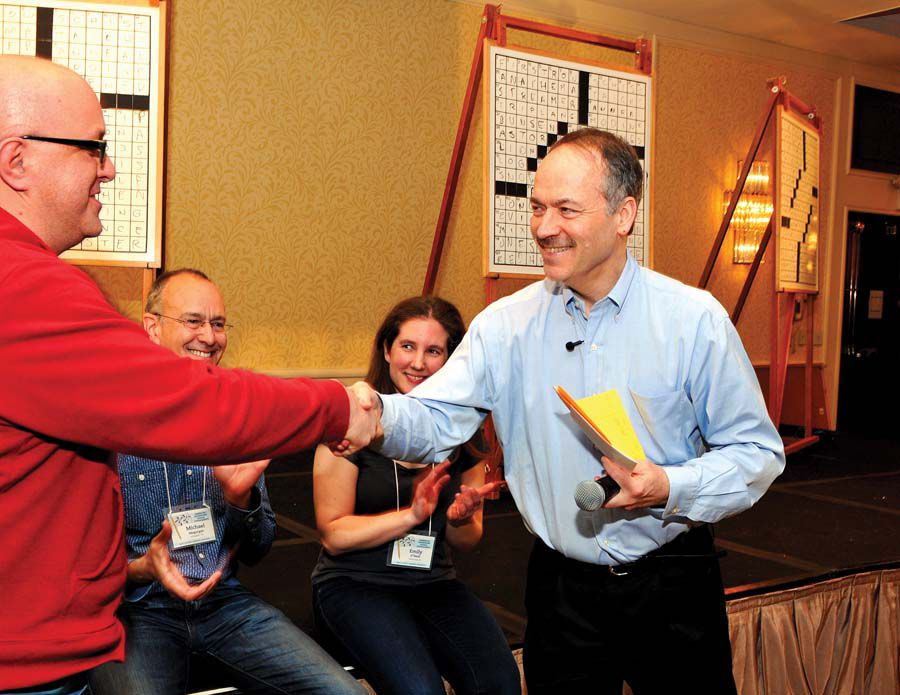 Will Shortz congratulating a 2016 group winner_Photo by Donald Christensen.jpg