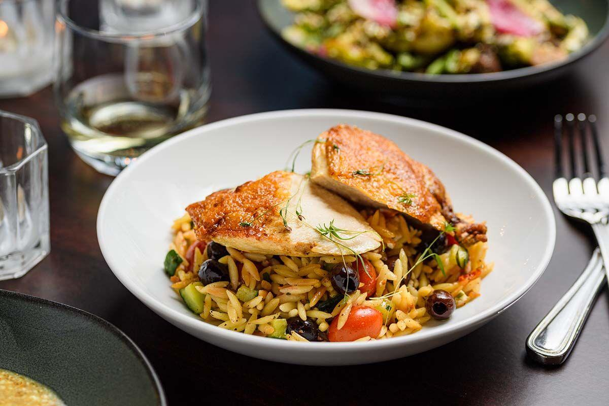Chicken - pan roasted chicken breast with toasted orzo salad, goat cheese, smoked tomatoes and cucumbers, charred scallions and green onion cream (1).jpg