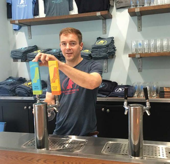 Bill Shufelt pours a beer at Athletic Brewing Co. in Stratford.