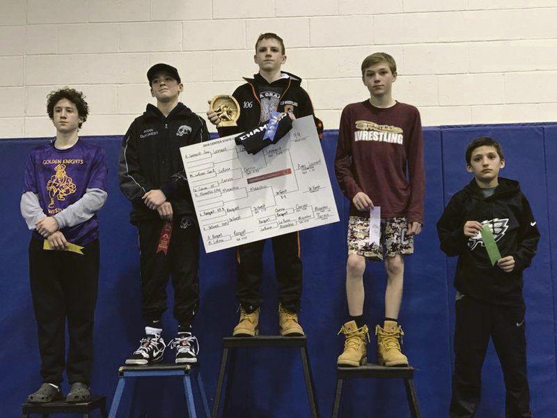 Kennedy, Leonard win CSC wrestling titles