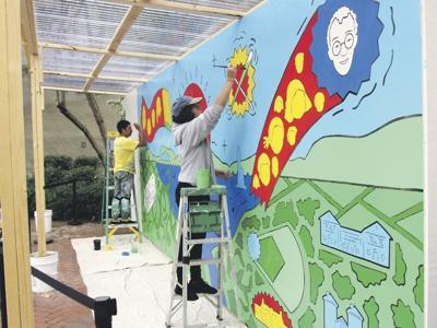 Mural celebrates village's past, present