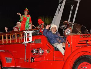 <p>Santa waves to the gathered parade-goers as he makes his way down Orange Ave. during the 2018 Chamber Of Commerce Holiday Parade. There is a full evening of holiday-related activities planned for this Friday, Dec. 6. Carols will be sung at Rotary Plaza from 5 to 6 p.m. and Santa's arrival via fire truck will come toward the end of that time frame. The 44th Annual Holiday Parade will start at 6 p.m. and last until 7 p.m.</p>