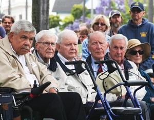 <p>Last year, Memorial Day ceremonies at Star Park drew an impressive crowd. Here, from left, are Moki Martin, Emil Reutzel, Bill Lipman, Irish Flynn and Dennis McCormick, preparing to lay a wreath in honor of fallen UDT and SEAL comrades. There was not a dry eye in the place.</p>