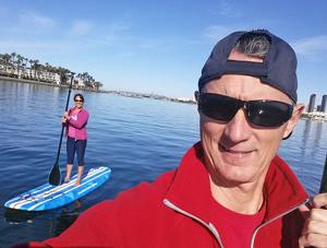 <p>Paddleboarding on the Bay is just one of the many attractions that helped draw Jennifer Rubin to Coronado. Jennifer, pictured here with husband Micheal, has become a vocal advocate for the Coronado community potentially impacted by changes to the Port Master Plan.</p>