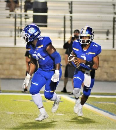 Tiger QB Adrian Baston and tailback Anthony Young
