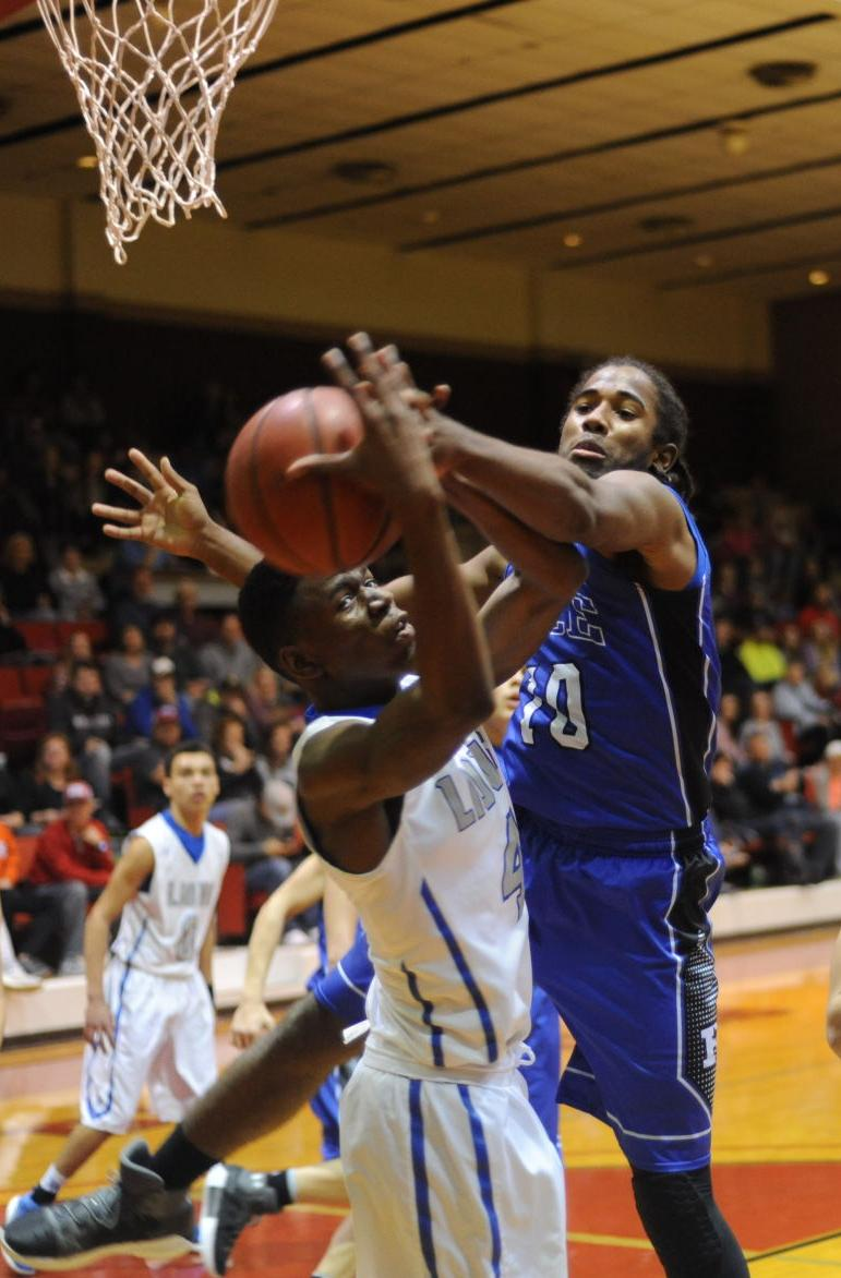Rice's Tre' Jessie and Blooming Grove's Stephen Carroll battle for a rebound.