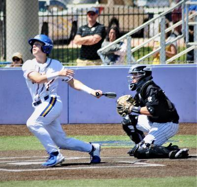 Aiden Morehouse lifts a sac fly