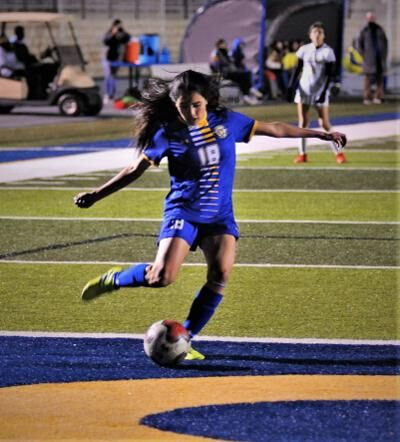 Briana Torres clears the ball