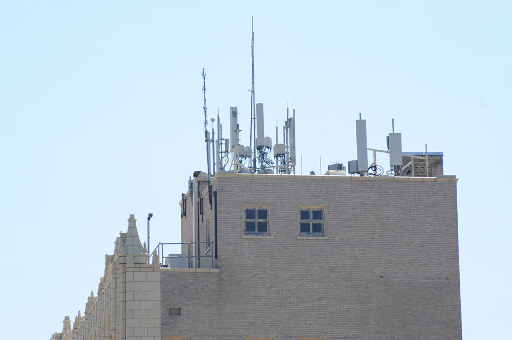 Antennae On The Roof Of The Chase Bank Building, Located At 101 N. Beaton  St. Are The Subject Of Debate.