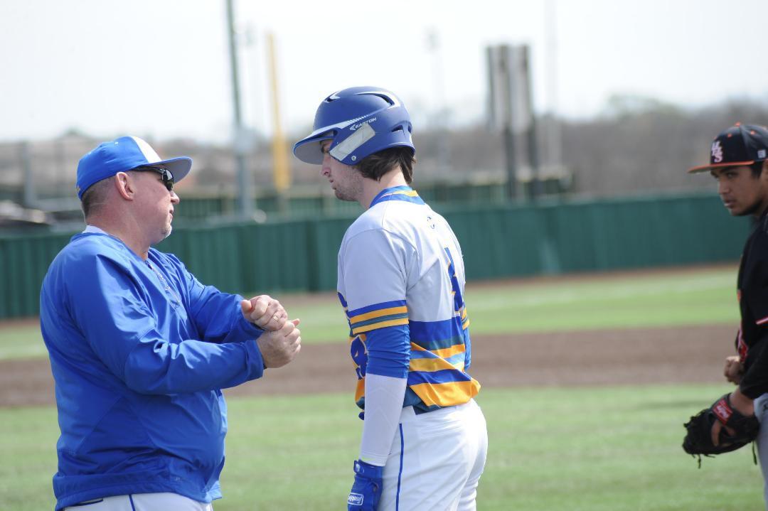 Tigers coach Heath Autrey talks with Micha Burke