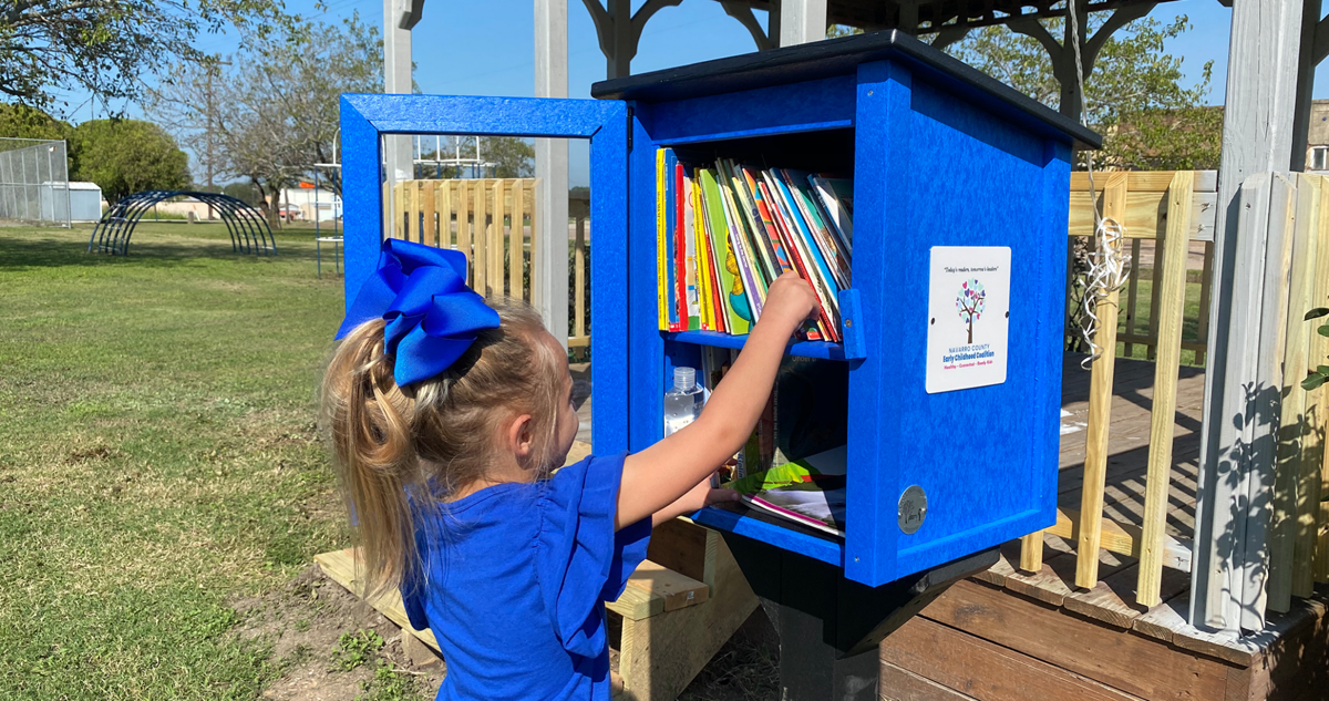 Little-Libraries-girl in blue bow.png