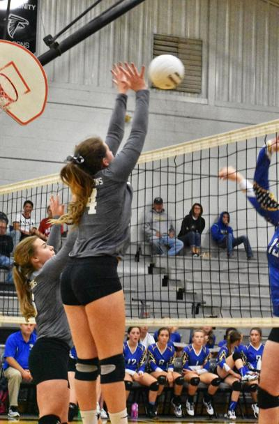 Jacinda Reed goes up for a big block during Wayne's conference win against Martensdale St. Mary's.