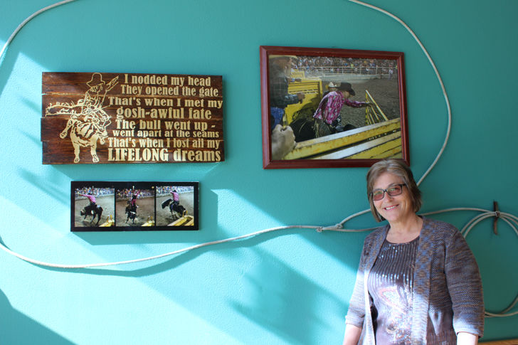 Sharon Anderson stands beside the Doug Fetters memorial wall inside newly remodeled Outlaw Pizza on Corydon square