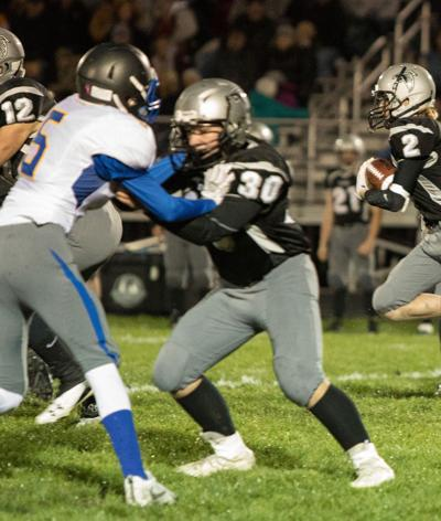 Hunter Clark helps clear path for Jakson Cobb as he pushes towards goal line during Friday night's matchup against Martensdale-St. Marys.