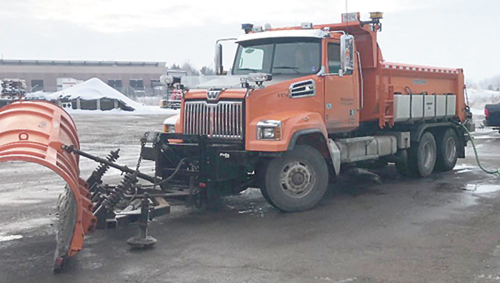 Snowplows spread beet product on roads