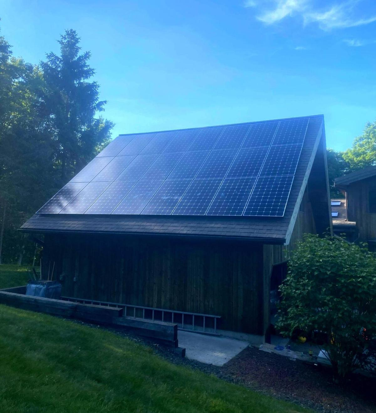 New Milford green home ups ante with solar, geothermal components