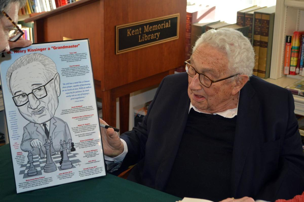 Kissinger visits Kent, receives caricature from artist