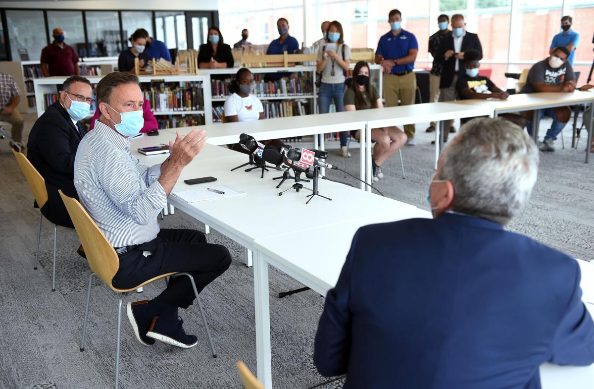 Lamont pushes in-person school, with mixed reaction