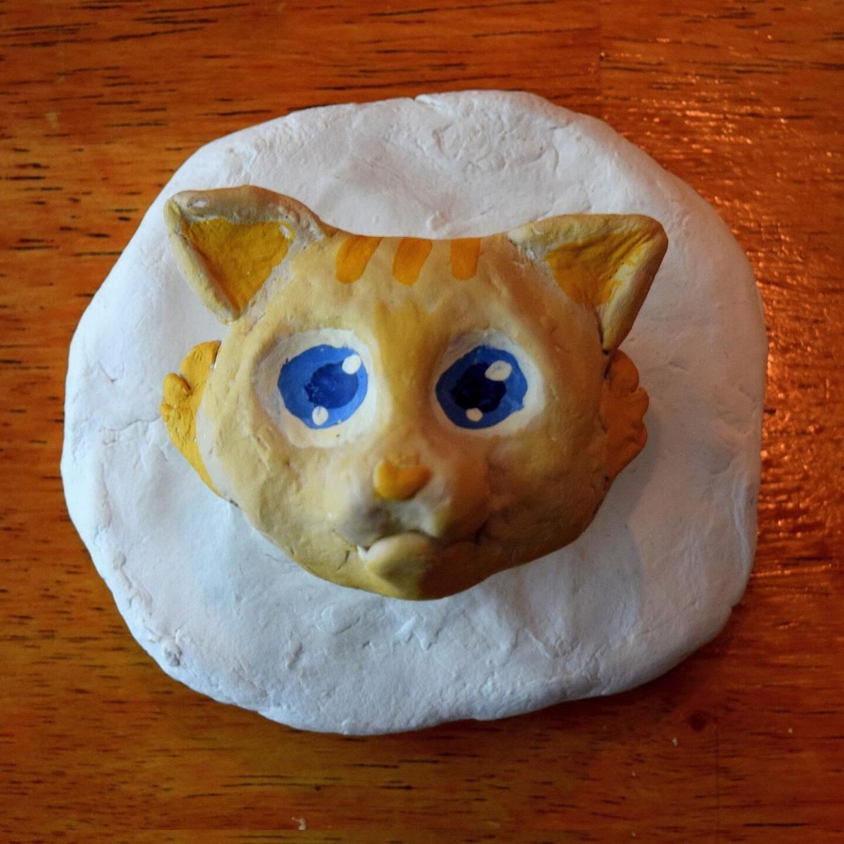 Young Litchfield artist finds her groove with cat sculpture
