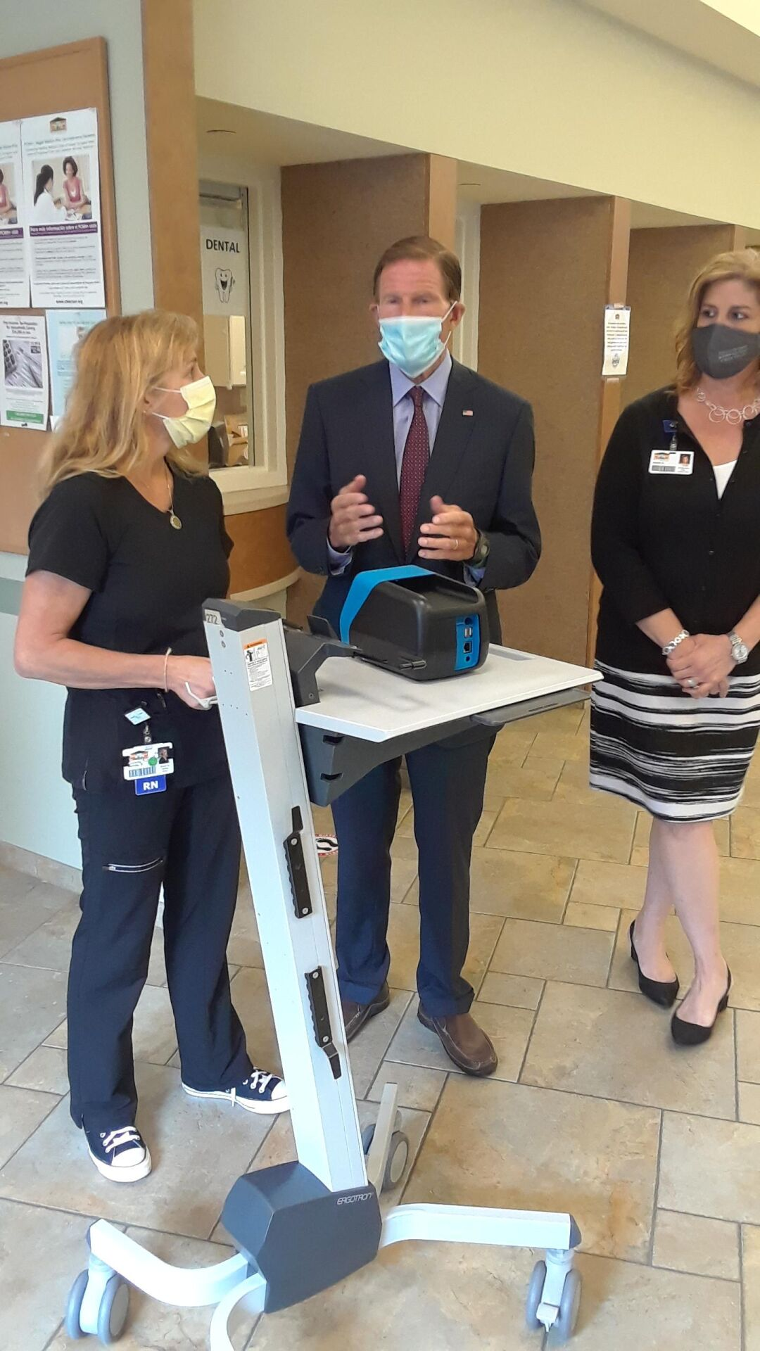 Blumenthal visits health center to see new rapid result testing machine for COVID-19, flu