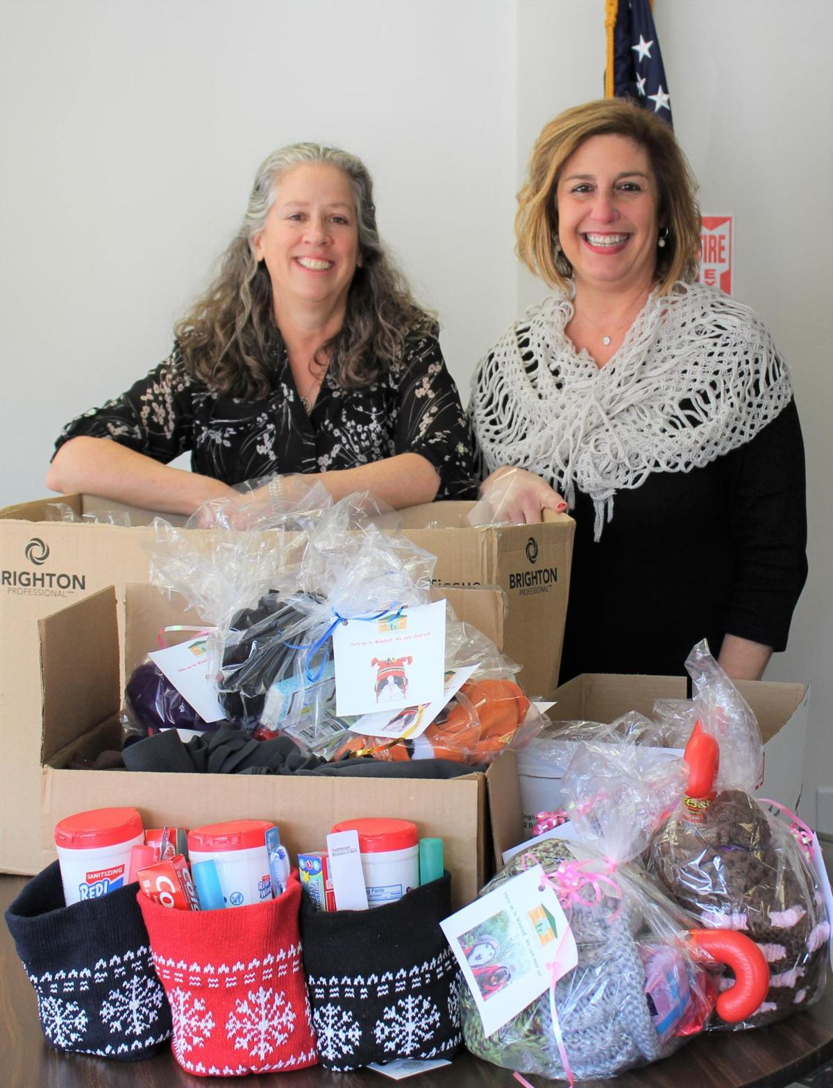 Torrington health center donates warming gifts to Winsted shelter
