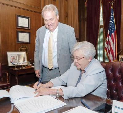 Ivey Signs Sen. Melson's Bill