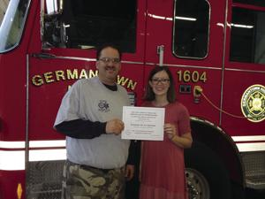 Germantown Hills Fire Chief Chip Wilmot with Melissa Peters
