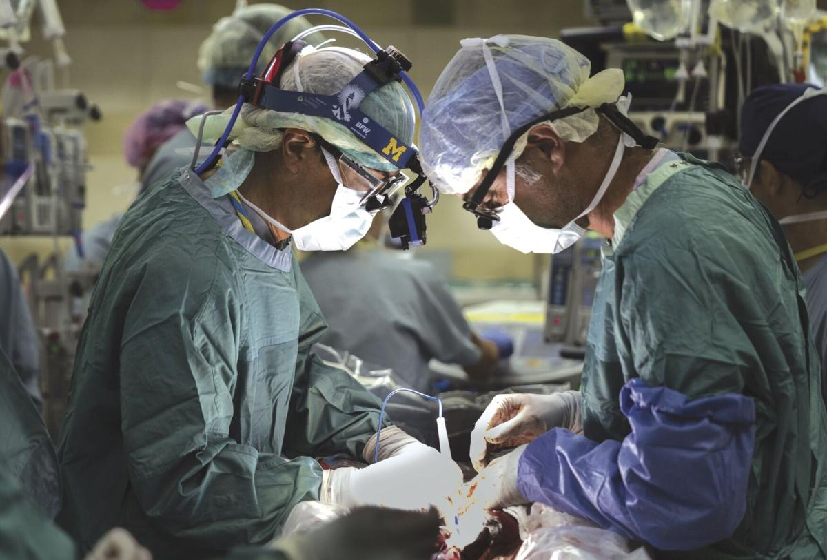 Two surgeons, WCHS graduates, operate together to separate conjoined twins