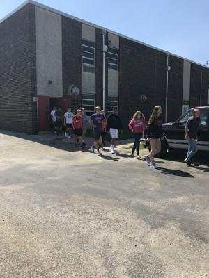 <p>Students file outside Metamora Township High School earlier this month. It was part of a mock shooter exercise. MTHS has adopted the ALiCE technique, which is a proactive approach designed to interrupt a violent intruder's decision making and ability to shoot accurately.</p>