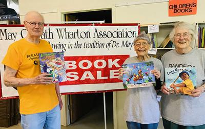 7-13 Wharton Assn. Book Sale Co-chairs Ted and Martha McKnight with volunteer Goldie Schneider at center.jpg