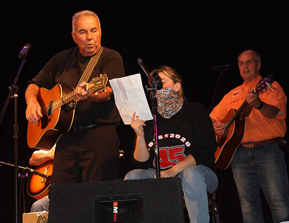 Larry Opatik and Brianna Sherrill duet with accompaniment by Jim Radle.JPG